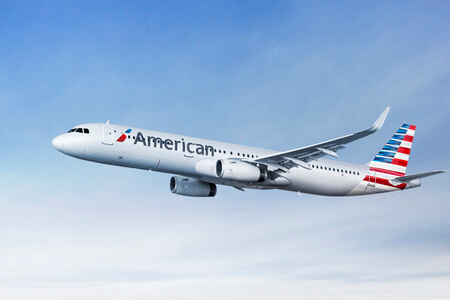 american airlines airbus a321neo airborne in flight side view