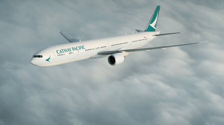 cathay pacific boeing 777 300er b kpm airborne over clouds