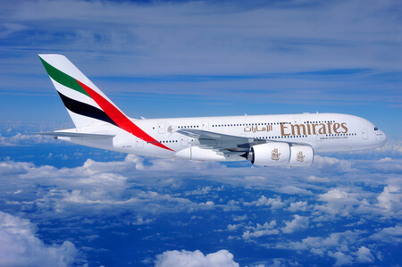 emirates airbus a380 800 a6 eda airborne over clouds flying right