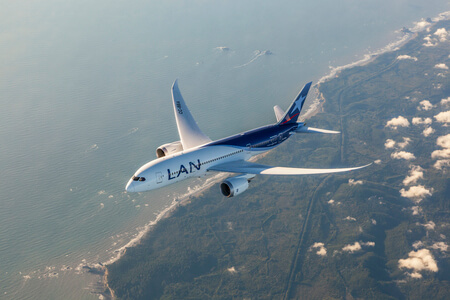 lan airlines boeing 787 8 cc bba airborne over coastline taken from above