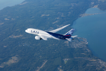 lan airlines boeing 787 8 cc bba airborne over landscape
