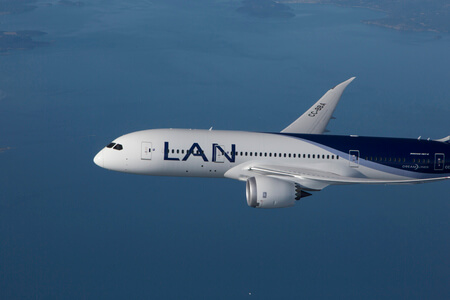 lan airlines boeing 787 8 cc bba airborne over sea nose view