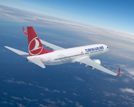 turkish airlines boeing 737 800 airborne over sea winglets